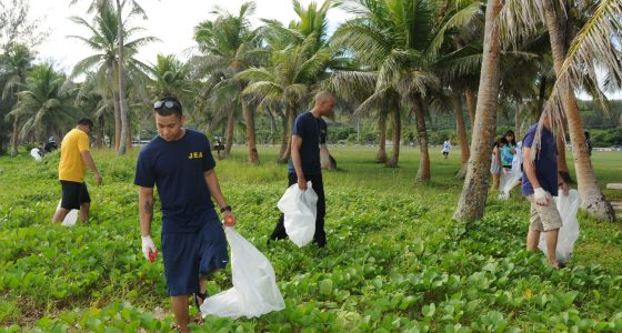 110917-N-BT122-446 ASAN, Guam (Sept. 17, 2011) Sailors assigned to the submarine tender USS Frank Cable (AS 40) pick up trash during a community service event at the War in the Pacific National Historical Park at Asan Beach. Frank Cable conducts maintenance and support of submarines and surface vessels deployed in the U.S. 7th Fleet area of responsibility. (U.S. Navy photo by Mass Communication Specialist 1st Class Melvin Nobeza/Released)